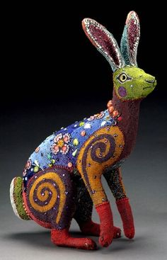 Betsy Youngquist is an American artist. Her mixed media beadwork weaves together the human and animal spirit through a surrealistic sight.