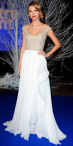 Taylor Swift in white Reem Acra gown at the Winter Whites Gala in London