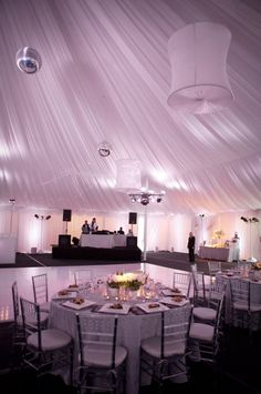 This wedding was on Platinum Weddings. The ceremony taking place on the golf course with the reception inside a draped tent constructed over the tennis club and filled with over 10,000 different varieties of white tulips. Coordination by Laurie Davies of Five Star Weddings and Events, Linens by Fusion, rentals by Classic Party Rentals, Lighting by SHINE Orange County.