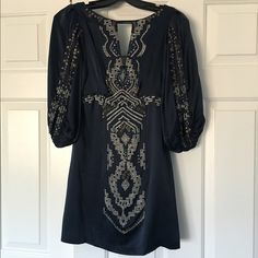 Nanette Lepore 100% silk minidress with beadwork Nanette Lepore navy minidress, size 0. 100% silk with lining. Beadwork throughout-in excellent condition. Worn only once. Nanette Lepore Dresses Mini