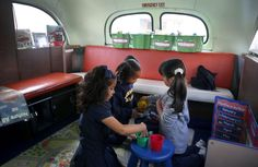 Valentina Morales (left), Mariah Andrews (center) and Yaretzi Prado play during a preschool operating out of an old bus at the Aspire Monarch Academy school in Oakland, Calif. on Wednesday, Nov. 18, 2015. Photo: Paul Chinn, The Chronicle