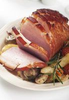 Score  the ham to create a crispier skin and allow the glaze to seep into the  meat.