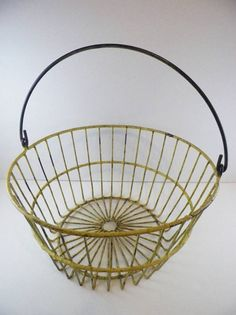 Whether to display or use, this is a great Vintage Primitive Wire Egg Basket! Yellow Farm by GsEclecticAttic