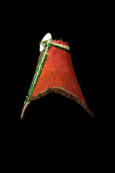 """Papua New Guinea: Western Highlands. A ceremonial headdress (""""peng koem""""), worn in the Wahgi Valley by the Melpa people. It is (top to bottom) 47 cm high. Made of a large quantity of human hair on a rattan frame, resin, ochre, orchid fibre, green beetles, and white baler shell (note: typically NATURAL materials. Shown in *Ethnic Jewellery and Adornment*, p. 125."""