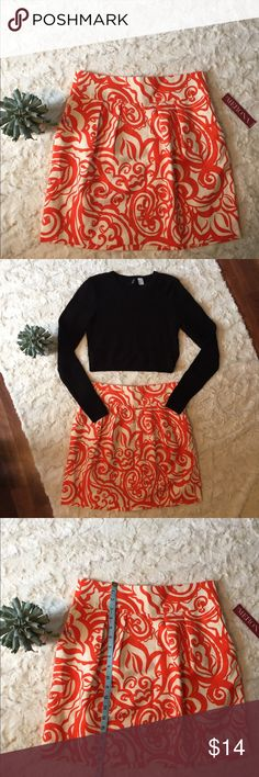 Merona mini skirt NWT Orange and cream mini skirt. Small black spots that may come out in wash. See photo. Crop top also for sale in my closet! Merona Skirts Mini
