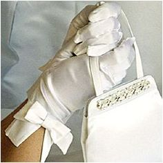 Carolina Amato Wedding Gloves. Elegant silk bridal gloves with fashion details.  Wrist length gloves with bow detail at wrist. Find your style at Perfect Details.