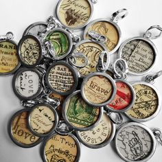 Recycled paper jewelry, pendants and charms made using REAL vintage postcards from Pick Up Sticks Jewelry Company. Upcycled old paper, letters, stamps, postmarks, and handwritten documents made into jewelry!