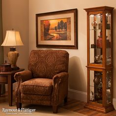 This Sutton curio with lighting in oak provides plenty of room to display your collectibles with elegance. It features a mirrored back for multiple viewing angles and interior lighting for extra ambiance.