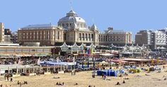 Scheveningen,in Holland.Here is a shopping mall ( the smaller,flat building) and a sophsiticated Spa ( the beautiful building ) .Both overlook this beach.