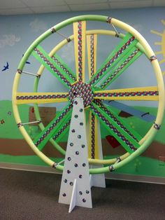 Colossal Coaster @ Botsford Baptist Church, Waynesboro, GA.  Ferris Wheel made with pool noodles & foam insulation board. The board is covered with duck tape. Electric grill rotisserie was used to make it turn thanks to suggestion from another Pinner.
