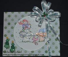 This is a cute Christmas Card made with a digital stamp from The Paper Shelter. The stamp is called Decorating Our Mushrooms. This was made for the challenge at Robyn's Fetish Challenge Blog. The paper is from DCWV, Cardstock from Close To My Heart, Trees from Dress It Up,  and Ribbon from my ribbon box.