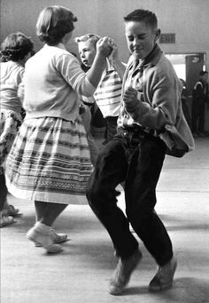 Lost in the moment at a school dance, 1950. What a cutie.