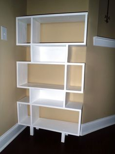 nice looking modern shelving. I wanted to build a good looking and practical bookshelf for our new  apartement Since the is on top floor ceiling angular