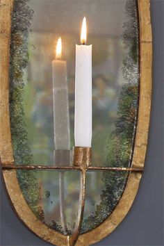 HGTV Green Home 2012: Candle sconce in living room - maybe for our dining room if we don't want electric?