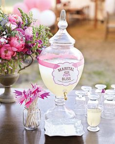 Love the look of this and the little things too, a cute dish to catch the spills, the drink flags, and the flower arrangement nearby