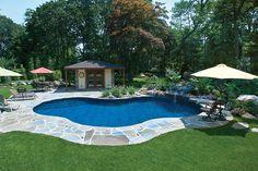 Inground swimming pool with colored brick decking