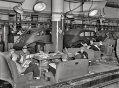 Sit-down strikers read newspapers instead of working at General Motors Fisher Body plant in Flint Michigan Fisher, Shorpy Historical Photos, Flint Michigan, American Auto, American History, Assembly Line, Automobile Industry, General Motors, Journaling