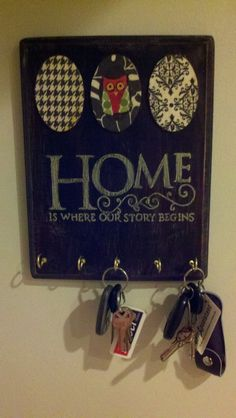 key holder rack with distressed wood, and scrap book paper modge podge on wooden plaques.  Easy!