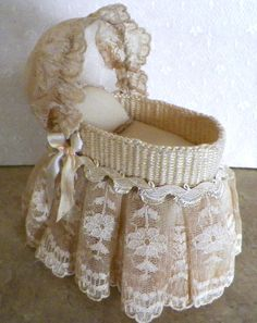 Handmade wicker bassinet, with vintage golden lace. Ruthellens Miniature Customs
