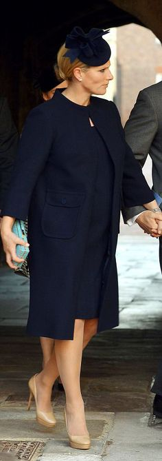 Zara Tindall, is the only member of the royal family chosen to be a godparent to Prince George. Zara draped her growing bump in chic navy.  She seemed to take inspiration from Victoria Beckham's maternity wardrobe as she arrived at St James's Palace wearing a simple navy coat and matching headpiece.