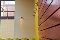 Nice deets - wood, chairs, punchy color, lights.  Lenora Lobby Remodel | International Studio Architecture, Inc