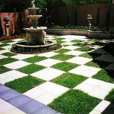 Modern outdoor garden space ~ checkerboard lawn ~ I love the visual contradiction between the old world style fountain with the modern design of the checkerboard...