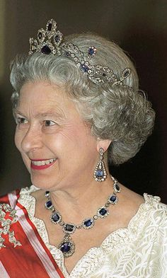 The Queen's Sapphire Tiara   This striking sapphire and diamond tiara was made at Queen Elizabeth's request in 1963 using gems from a necklace she had bought. It was designed to match the George VI Victorian Suite jewelry set given to the Queen by her father as a wedding present.