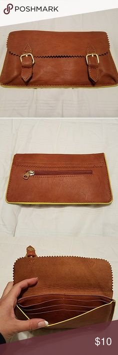 Pull & Bear wallet Tan with lime green piping 8.5 in x 4.5 in Hold 6 cards Vegan leather Can be used as a wallet or clutch Never used. New without tags Pull&Bear Accessories Key & Card Holders