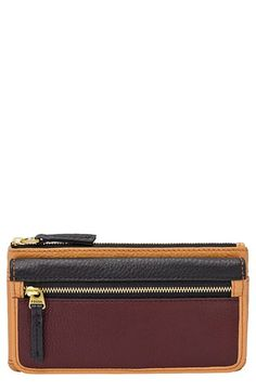 Free shipping and returns on Fossil 'Erin' Leather Clutch Wallet at Nordstrom.com. Rich color blocking freshens up a flap clutch wallet shaped with a streamlined profile and outfitted with plenty of organized storage space.