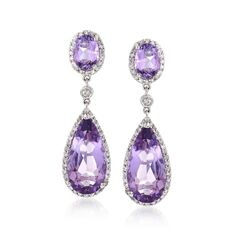 "C. 2000. Be bold and splashy with juicy-hued gemstone drop earrings. From our Estate collection, vivid 8.10 ct. t.w. amethysts are outlined in .65 ct. t.w. diamond for a big look that dazzles in polished 14kt white gold. Hanging length is 1 1/4"". Post/clutch, diamond and amethyst drop earrings. <b>Exclusive, one-of-a-kind Estate Jewelry.</b> Free shipping & easy 30-day returns. Fabulous jewelry. Great prices. Since 1952."