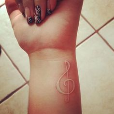 White ink music note tattoo - The symbol of music note is the representation of the wearer's hobby and the love of life.
