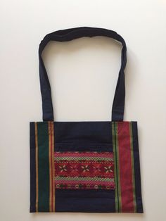 Handwoven tote bag with cross stitch. From Same and Different UK.