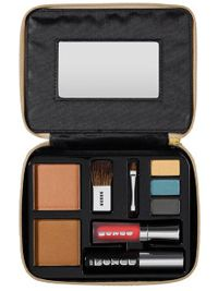 Buxom Passport Collection THE DAY TRIPPER EDITION This lightweight and compact face kit is housed in a chic gold pouch with a handy mirror, and has been designed to create a sun-kissed look with splashes of bright colour.