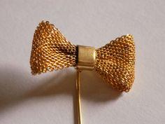 Vintage Diane von Furstenberg gold tone bow stick by joegems66