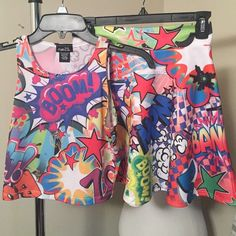Comic print bundle Comic book inspired skater skirt and crop top. Bright and bold. Wear together or as separates. Add a splash of color to your wardrobe. Measured flat skirt waist is 14 inches and length is 16 1/2 inches. Crop top from armpit to armpit is 15 1/2 inches. Shoulder seam to hem is 16 inches. Never worn Rue 21 Skirts Mini