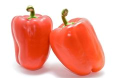 Red bell peppers 3-Two red bell peppesr isolated on a white background