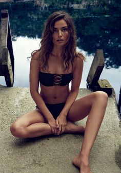 Andreea Diaconu models a black bandeau top and bikini bottoms from H&M 2016 swimsuit campaign