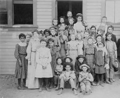 Class photograph in front of the Chatsworth school, circa 1900. Teachers: Mr. Maltly (in rear) and Miss Noyes (second from left). San Fernando Valley History Digital Library.