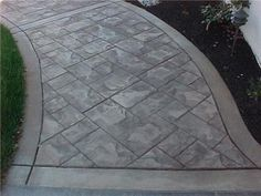 This walkway was colored using sand stone base color and then antique autumn brown release agent. The pattern was used was a small ashlar slate stamp placed at a 45 degree angle. The stamp pattern was framed with a 6 inch border and bands.                                                                                                               });      };      (function () {          var e