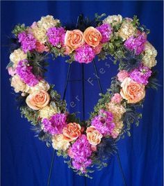 heart memorial flowers - did this for my Mom's funeral in pink roses. Simple and beautiful.