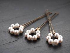 Hey, I found this really awesome Etsy listing at https://www.etsy.com/listing/65629264/pearl-halo-bridal-hair-pins-swarovski