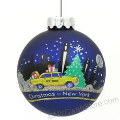 NYC Taxi Christmas Ornament, Glass Ball (http://www.nycwebstore.com/nyc-taxi-glass-ornament/)