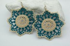 Crocheted eight pointed star earrings made with 100% cotton yarn in green blue and cream, and stiffened with a non toxic product. - by Ana Fernandez of LindaPaula on Etsy