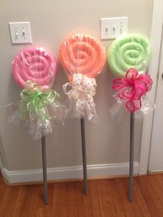 Large lollipops made from foam pool noodles, a LOT of hot glue, conduit pipe, and cellophane.  The kids loved these!  We used them a props for pictures with Santa!