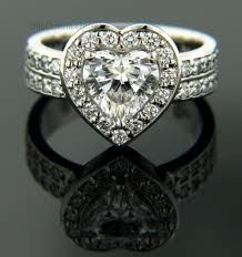 i need a heart shaped wedding ring. Never liked heart shaped till recently!!!  WANT!!!