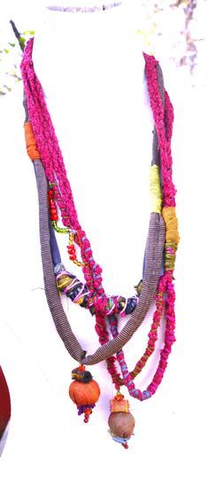 A very unique handmade fabric colorfull necklace to add a little extra for your outfit. Youll be definitely hearing lots of compliments whereever you
