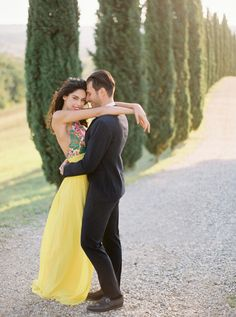 Tuscan engagement shoot: http://www.stylemepretty.com/destination-weddings/2017/03/24/a-colorful-engagement-in-the-hills-of-tuscany/ Photography: Darya Kamalova - http://www.thecablookfotolab.com/