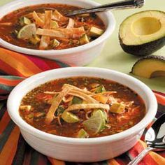 Mexican Tortilla Soup - I added black beans, pinto beans, corn, and chicken. Then topped with guacamole and cheese. Yum!