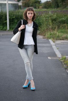 Master the effortlessly chic look in a black knit cardigan and grey ripped skinny jeans. Dress up this look with blue suede pumps.  Shop this look for $88:  http://lookastic.com/women/looks/peplum-top-cardigan-tote-bag-skinny-jeans-pumps/1957  — White Peplum Top  — Black Knit Cardigan  — Grey Leather Tote Bag  — Grey Ripped Skinny Jeans  — Blue Suede Pumps