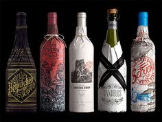 Stranger & Stranger wine packaging.  Decorative paper sleeves wrap around wine bottles in a fashion inspired by prohibition-era packaging.